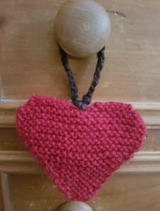 Homemade heart fitting in knitting decorative door hanger
