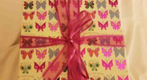 Pretty decorative box with butterflies, tied with an organza ribbon.