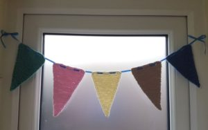 Handmade Knitted Bunting in Doorway Fitting in Knitting Children Quick Craft Ideas