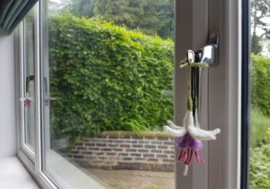 Handmade Knitted Fuchsias in Window Fitting in Knitting Children Quick Craft Ideas