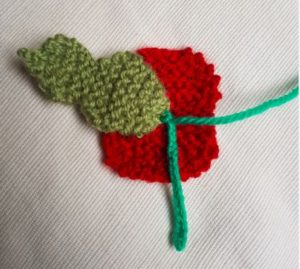 Handmade Knitted Poppy Garter Finished Back View Fitting in Knitting Children Craft Ideas