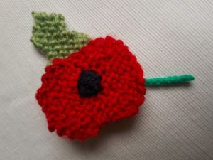Handmade Knitted Poppy Garter Finished Side View Fitting in Knitting Children Craft Ideas