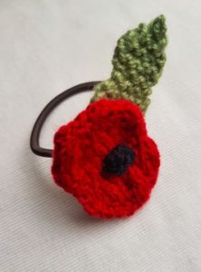 Handmade Knitted Poppy Hairband Front Fitting in Knitting Children Craft Ideas