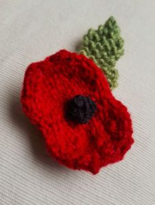 Handmade Knitted Poppy Stocking Completed Fitting in Knitting Children Craft Ideas