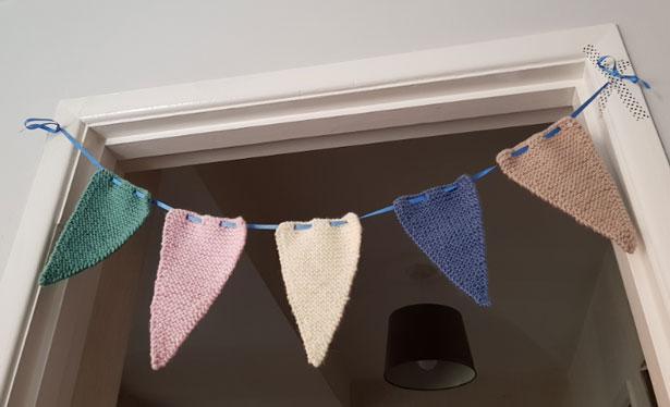 Handmade Knitted Bunting in Doorway