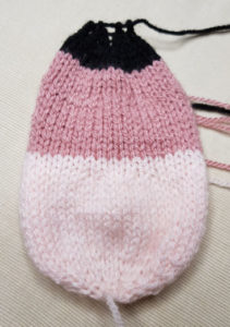 Handmade-Knitted-Flamingo-Head-Piece-Fitting-in-Knitting